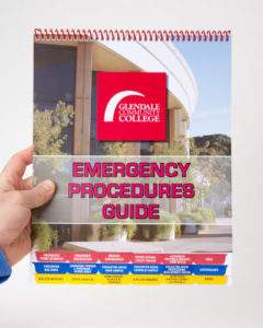 Emergency Response Guidebook with multiple, easy to read, color coded tabs that hangs on a wall.